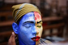 Artist model face painting lord shiva stock image