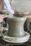 The artist mold the pottery on the circulated plate Royalty Free Stock Images