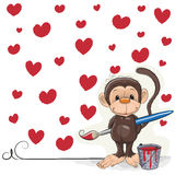 Artist Monkey. Cute Monkey with brush is drawing hearts Royalty Free Stock Photo