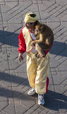 Artist with a monkey in Marrakesh Royalty Free Stock Image
