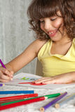 Artist for mother. Little girl making a drawing for mother's day royalty free stock images