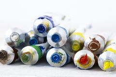 Free Artist Oil Paint Tubes In Various Colours On White Wood.  Art And Craft Supplies Stock Photo - 182111170
