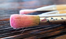 Artist Paint Brushes. Art brush lying on the table close-up royalty free stock images