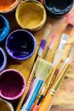 Artist paint brushes and paint cans of paint over. Art paint artist brushes cans colors group stock photo