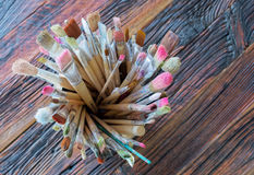 Artist Paint Brushes. Artist Paintbrushes. A lot of paint brushes used with paint residues stock image