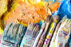 Artist paint brushes and palette. Old brushes. Close up stock illustration