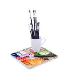 Artist paint brushes and palette on white background Royalty Free Stock Image
