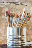 Artist Paint Brushes. Used kit paint brushes in can royalty free stock photo