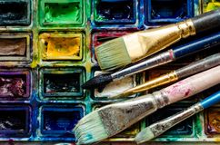 Artist paint brushes and watercolor paintbox stock photo