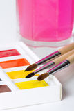 Artist paint brushes on watercolor paints Stock Photos