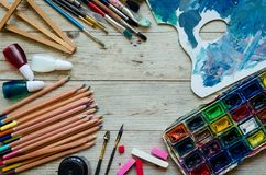 Artist paint brushes on the wooden background stock photos