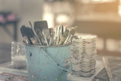 Artist paintbrushes in bucket. Stock Photography