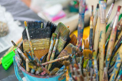 Artist paintbrushes in bucket. Stock Image