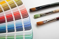 Artist paintbrushes with color samples stock images