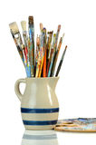Artist Paintbrushes in a Jar and Palette Royalty Free Stock Image
