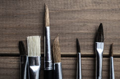 Artist Paintbrushes Overhead on Wood Planks Stock Photo