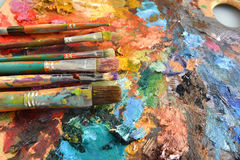 Artist Paintbrushes on Palette stock images