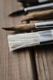 Artist Paintbrushes on Wood Planks Stock Photo