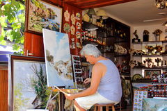 The artist, painter draws a picture Royalty Free Stock Photos