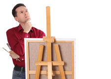 Artist Painter by the Easel. Thinking Isolated stock images