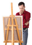 Artist Painter by the Easel. Thinking Isolated royalty free stock photos