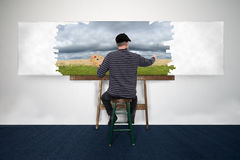 Artist and Painter Paint Oil Painting Landscape on White Canvas. Artist and painter is painting a nature landscape. The man is creating his art with oil paint royalty free stock photos