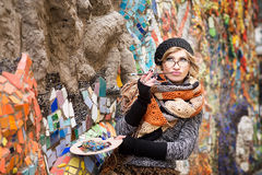 Artist, painter woman with canvas on mosaic background Royalty Free Stock Image