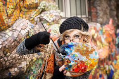Artist, painter woman at work. Delight, surprise, admiration Royalty Free Stock Image