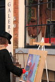 Artist painting art on canvas stock photography