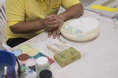 Artist painting art mask. Stock Photo