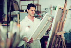 Artist painting on canvas Royalty Free Stock Photography