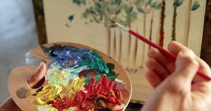 Artist painting on canvas 4k. Artist painting on canvas in drawing class 4k stock footage