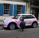 Artist painting a car Stock Photos