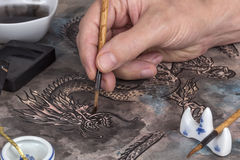 Artist painting a Chinese dragon Stock Photography