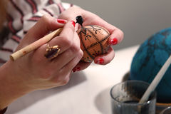 Artist painting easter egg. Royalty Free Stock Images