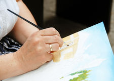 Artist painting hand Stock Images