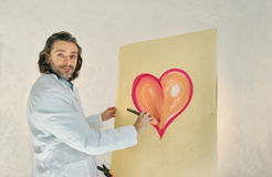 Artist painting heart Stock Photography