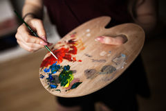 Artist Painting In Her Workshop Stock Photography