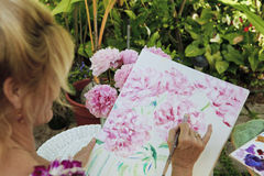 Artist painting outside Royalty Free Stock Photos