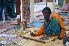 The artist. Artist painting pattachitra in local art fair in bengal, India Royalty Free Stock Photo