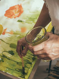 Artist painting picture on canvas with watercolours.  royalty free stock photo