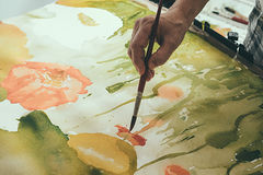 Artist painting picture on canvas with watercolours Stock Photography