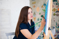 Artist painting picture on canvas. Whith watercolours royalty free stock photo