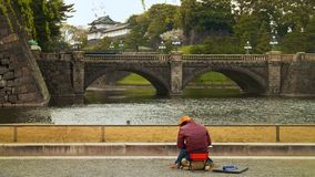 Artist painting picture. In front of the palace of Japan Royalty Free Stock Photo