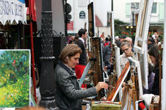 Artist painting picture on Montmartre in Paris Stock Images