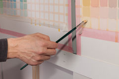 Artist is painting a picture - squares using a paint brush Stock Image