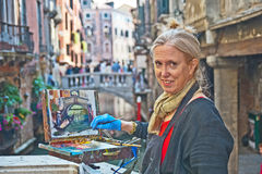 Artist  painting picture of  Venice canal. Royalty Free Stock Image