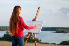 Artist painting an sea. Landscape Royalty Free Stock Images