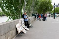 Artist painting by the seine river Stock Images