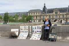 Artist painting by the seine river Royalty Free Stock Photo